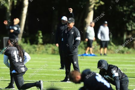 Oakland Raiders' head coach supervises the NFL training session at the Grove Hotel in Chandler's Cross, Watford, England, . The Oakland Raiders are preparing for an NFL regular season game against the Chicago Bears in London on Sunday