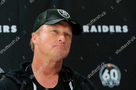 Oakland Raiders' head coach Jon Gruden attends a press conference after a practice session at the Grove Hotel in Chandler's Cross, Watford, England, . The Oakland Raiders are preparing for an NFL regular season game against the Chicago Bears in London on Sunday