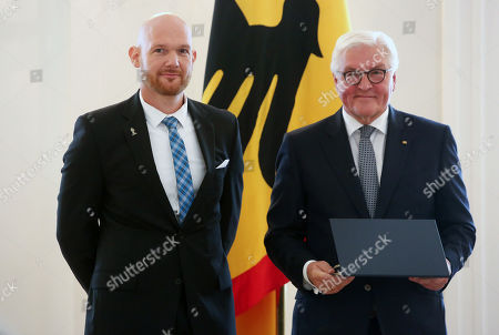 Stock Image of Astronaut Alexander Gerst is awarded the German Federal Order of Merit (Verdienstorden) by German President Frank-Walter Steinmeier at Bellevue Presidential Palace in Berlin, Germany, 02 October 2019. The Verdienstorden, the only federal decoration in the country, has been awarded since its creation in 1951 to over 200,000 individuals, and is intended to 'express recognition and gratitude to deserving men and women.' The government timed this particular edition of the ceremony with the 29th anniversary of German reunification the following day.