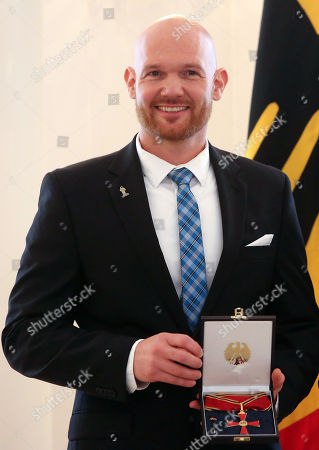 Stock Picture of Astronaut Alexander Gerst is awarded the German Federal Order of Merit (Verdienstorden) by German President Frank-Walter Steinmeier (unseen) at Bellevue Presidential Palace in Berlin, Germany, 02 October 2019. The Verdienstorden, the only federal decoration in the country, has been awarded since its creation in 1951 to over 200,000 individuals, and is intended to 'express recognition and gratitude to deserving men and women.' The government timed this particular edition of the ceremony with the 29th anniversary of German reunification the following day.