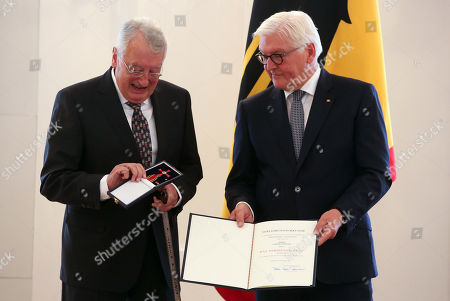 Stock Picture of Journalist Ulrich Schwarz (L) is awarded the German Federal Order of Merit (Verdienstorden) by German president Frank-Walter Steinmeier at Bellevue Presidential Palace in Berlin, Germany, 02 October 2019. The Verdienstorden, the only federal decoration in the country, has been awarded since its creation in 1951 to over 200,000 individuals, and is intended to 'express recognition and gratitude to deserving men and women.' The government timed this particular edition of the ceremony with the 29th anniversary of German reunification the following day.