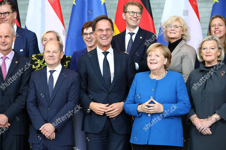 (Front L-R) Dutch Minister for Foreign Affairs Stef Blok, German Minister of Finance Olaf Scholz, Dutch Prime Minister Mark Rutte, German Chancellor Angela Merkel, Dutch State Secretary for Justice and Security Ankie Broekers-Knol, (Rear L-R) German Minister of Economic Cooperation and Development Gerd Mueller, Dutch Minister of Defense Ank Bijleveld, German Defense Minister Annegret Kramp-Karrenbauer, Dutch Minister of Legal Affairs Sander Dekker, German Minister of Justice Christine Lambrecht, Dutch Minister of Agriculture, Nature and Food Quality Carola Schouten pose for a family photo during the German-Dutch government consultations at the chancellery in Berlin, Germany, 02 October 2019. The delegations will discuss issues regarding foreign policy, Europe, climate and energy, security and more. The consultations take place for the third time.