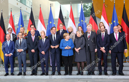 (Front L-R) Dutch Secretary of State for Home Affairs and Kingdom Relations Raymond Knops, German Minister of Foreign Affairs Heiko Maas, Dutch Minister for Foreign Affairs Stef Blok, German Minister of Finance Olaf Scholz, Dutch Prime Minister Mark Rutte, German Chancellor Angela Merkel, Dutch State Secretary for Justice and Security Ankie Broekers-Knol, German Minister of Interior, Construction and Homeland Horst Seehofer, Dutch Minister for Economic Affairs and Climate Eric Wiebes, German Minister of Economy and Energy Peter Altmaier, (Rear L-R) German Ambassador to the Netherlands Dirk Brengelmann, Minister for Foreign Trade and Development Cooperation Sigrid Kaag, German Minister of Economic Cooperation and Development Gerd Mueller, Dutch Minister of Defense Ank Bijleveld, German Defense Minister Annegret Kramp-Karrenbauer, Dutch Minister of Legal Affairs Sander Dekker, German Minister of Justice Christine Lambrecht, Dutch Minister of Agriculture, Nature and Food Quality Carola Schouten, German Minister of Food and Agriculture Julia Kloeckner, Dutch State Secretary for Economic and Climate Affairs Mona Keijzer, German State Secretary at the Chancellery Rita Schwarzelühr-Sutter, pose for a family photo during the German-Dutch government consultations at the chancellery in Berlin,  Germany, 02 October 2019. The delegations will discuss issues regarding foreign policy, Europe, climate and energy, security and more. The consultations take place for the third time.