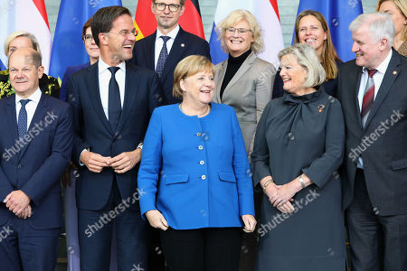 (Front L-R) German Minister of Finance Olaf Scholz, Dutch Prime Minister Mark Rutte, German Chancellor Angela Merkel, Dutch State Secretary for Justice and Security Ankie Broekers-Knol, German Minister of Interior, Construction and Homeland Horst Seehofer, (Rear L-R) Dutch Minister of Defense Ank Bijleveld, German Defense Minister Annegret Kramp-Karrenbauer, Dutch Minister of Legal Affairs Sander Dekker, German Minister of Justice Christine Lambrecht, Dutch Minister of Agriculture, Nature and Food Quality Carola Schouten, German Minister of Food and Agriculture Julia Kloeckner, pose for a family photo during the German-Dutch government consultations at the chancellery in Berlin, Germany, 02 October 2019. The delegations will discuss issues regarding foreign policy, Europe, climate and energy, security and more. The consultations take place for the third time.