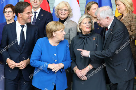 (Front L-R) Dutch Prime Minister Mark Rutte, German Chancellor Angela Merkel, Dutch State Secretary for Justice and Security Ankie Broekers-Knol, German Minister of Interior, Construction and Homeland Horst Seehofer, (Rear L-R) German Defense Minister Annegret Kramp-Karrenbauer, Dutch Minister of Legal Affairs Sander Dekker, German Minister of Justice Christine Lambrecht, Dutch Minister of Agriculture, Nature and Food Quality Carola Schouten, German Minister of Food and Agriculture Julia Kloeckner, pose for a family photo during the German-Dutch government consultations at the chancellery in Berlin, Germany, 02 October 2019. The delegations will discuss issues regarding foreign policy, Europe, climate and energy, security and more. The consultations take place for the third time.