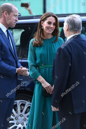 Prince William, Prince William and Catherine, Catherine Duchess of Cambridge are greeted by Prince Shah Karim Al Hussaini, Prince Karim Aga Khan during a visit to the Aga Khan Centre