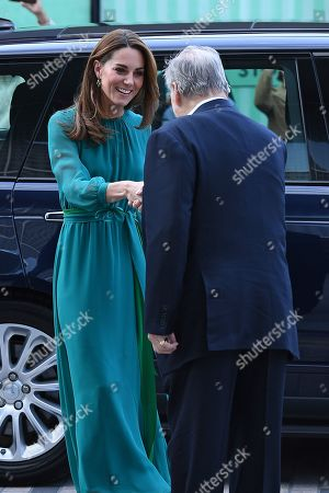 Stock Picture of Catherine Duchess of Cambridge is greeted by Prince Shah Karim Al Hussaini, Prince Karim Aga Khan during a visit to the Aga Khan Centre