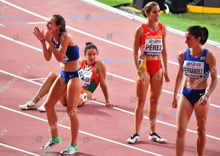 Jenny Simpson (L) of the USA reacts after competing in during the women's 1,500m heats at the IAAF World Athletics Championships 2019 at the Khalifa Stadium in Doha, Qatar, 02 October 2019.