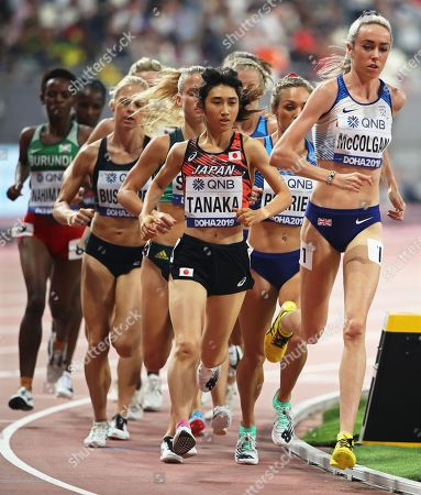 Nozomi Tanaka (C) of Japan and Eilish McColgan (R) of Britain in action during the women's 5,000m heats at the IAAF World Athletics Championships 2019 at the Khalifa Stadium in Doha, Qatar, 02 October 2019.