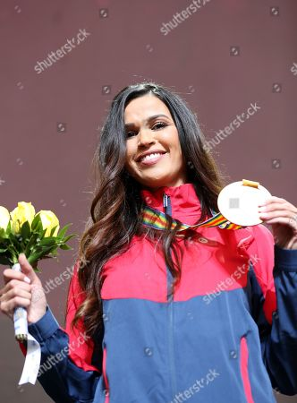 Habiba Ghribi of Tunisia poses with her gold medal which she received during the IAAF World Athletics Championships 2019 at the Khalifa Stadium in Doha, Qatar, 02 October 2019, after being promoted to 1st place for her performance in the women's 3,000m Steeplechase final at the IAAF World Championships 2011. The IAAF World Championships in Doha see the reallocation of a number of world championship medals. These upgrades follow the disqualification of the results of the original medalists after their sanction for anti-doping rule violations.