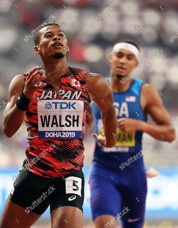 Julian Jrummi Walsh (L) of Japan crosses the finish line during the men's 400m semi finals at the IAAF World Athletics Championships 2019 at the Khalifa Stadium in Doha, Qatar, 02 October 2019.