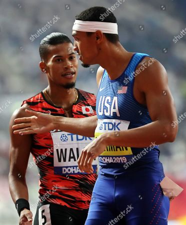 Julian Jrummi Walsh (L) of Japan and Michael Norman (R) of the USA react after competing in the men's 400m semi finals at the IAAF World Athletics Championships 2019 at the Khalifa Stadium in Doha, Qatar, 02 October 2019.