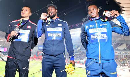 Stock Photo of Gold medalist Noah Lyles (C) of the USA, silver medalist Andre de Grasse (L) of Canada and bronze medalist Alex Quinonez of Ecuador during the medal ceremony for the Men's 200m at the IAAF World Athletics Championships 2019 at the Khalifa Stadium in Doha, Qatar, 02 October 2019.