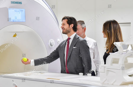 Stock Picture of Princess Sofia of Sweden and Prince Carl Philip get to try Microscope and MRI-equipment at the Brain Imaging Centre