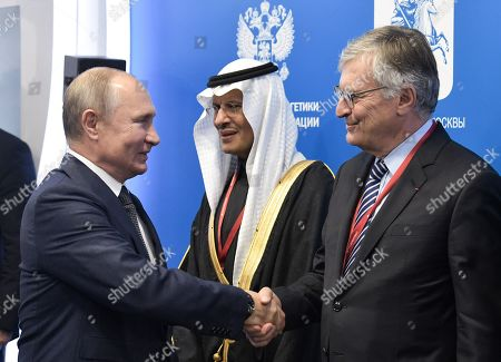 Russian President Vladimir Putin (L) shakes hands with World Energy Council Chairman Jean-Marie Dauger (R) as Prince Abdulaziz bin Salman, the Saudi Minister of Energy (C) looks on during the 2019 Russian Energy Week international forum in Moscow, Russia, 02 October 2019. The forum takes place from 02 to 05 October.