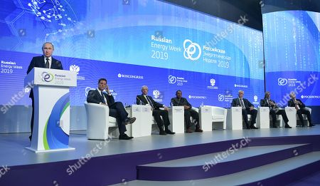 (L-R) Russian President Vladimir Putin  delivers a speech as as moderator, NBC News correspondent Keir Simmons, British Petroleum (BP) Group Chief Executive Bob Dudley, OPEC Secretary General Mohammad Sanusi Barkindo, Exxon Mobil Corporation Chairman and CEO Darren Woods, OMV AG Chairman of the Executive Board and CEO Rainer Seele, and Fortum Corporation President and CEO Pekka Lundmark listen during a plenary session entitled 'Energy Partnership for Sustainable Growth' during the 2019 Russian Energy Week international forum in Moscow, Russia, 02 October 2019. The forum takes place from 02 to 05 October.