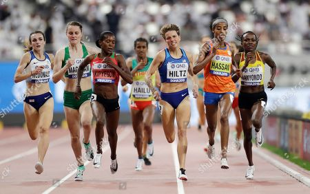 Winnie Nanyondo, of Uganda, Sifan Hassan, of the Netherlands, Nikki Hiltz, of the United States, Faith Kipyegon, of Kenya, Ciara Mageean, of Ireland, and Sarah Mcdonald, of Great Britain compete in the the women's 1500 meter heats at the World Athletics Championships in Doha, Qatar