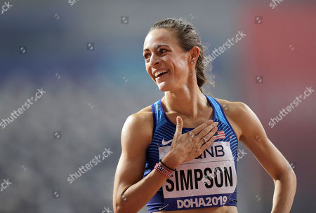 Jenny Simpson of the United States reacts after finishing women's 1500 meter heats at the World Athletics Championships in Doha, Qatar