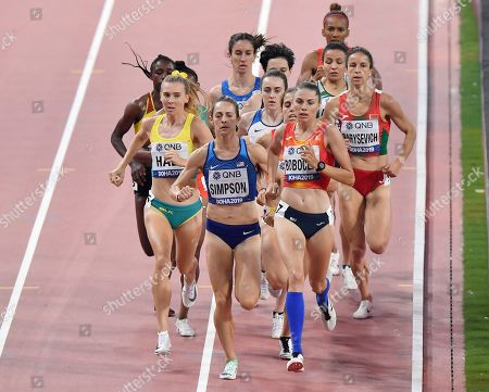 Jenny Simpson, of the United States, center, Linden Hall, of Australia, left, and Claudia Mihaela Bobocea, of Romania, from left, the women's 1500 meter heats at the World Athletics Championships in Doha, Qatar