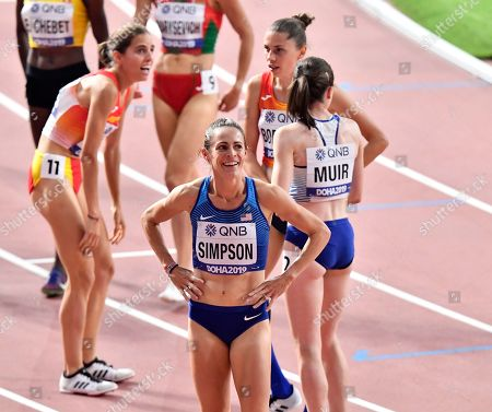 Jenny Simpson, of the United States, is all smiles after the women's 1500 meter heats at the World Athletics Championships in Doha, Qatar