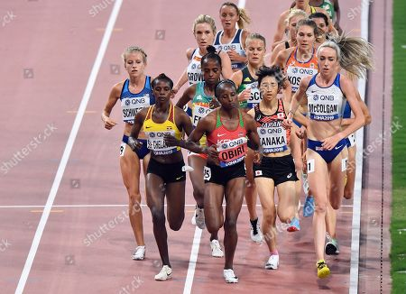 Stock Photo of Karissa Schweizer, of the United States, Sarah Chelangat, of Uganda, Hellen Obiri, of Kenya, Nozomi Tanaka, of Japan, and Eilish Mccolgan, of Great Britain, front row from left, compete in the women's 5000 meter heats at the World Athletics Championships in Doha, Qatar