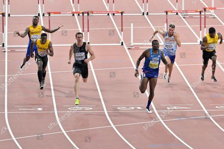 Shane Brathwaite, of Barbados, rear left, gestures as he ends up in the wrong lane as Ronald Levy, of Jamaica, Sergey Shubenkov, participates as a neutral athlete, Grant Holloway, of the United States, Andrew Pozzi, of Great Britain, and Orlando Bennett, of Jamaica, from left, compete in the men's 110 meter hurdles semifinals at the World Athletics Championships in Doha, Qatar