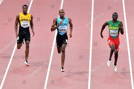 Demish Gaye, of Jamaica, Steven Gardiner, of Bahamas, and Kirani James, of Grenada, from left, compete in the men's 400 meter semifinal at the World Athletics Championships in Doha, Qatar