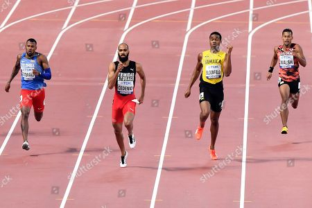 Anthony José Zambrano, of Colombia, Machel Cedenio, of Trinidad And Tobago, Akeem Bloomfield, of Jamaica, and Julian Jrummi Walsh, of Japan, from left, compete in the men's 400 meter semifinal at the World Athletics Championships in Doha, Qatar