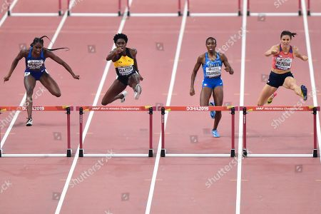 Ashley Spencer of the United States, Rushell Clayton of Jamaica, Ayomide Folorunso of Italy and Zuzana Hejnova of the Czech Republic, from left, compete during the women's 400 meter hurdles semifinal's at the World Athletics Championships in Doha, Qatar