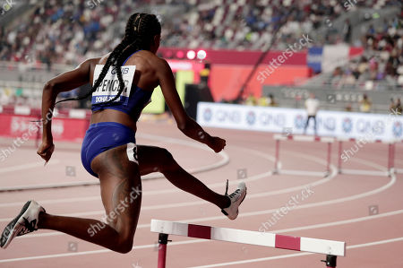 Ashley Spencer of the United States clears a barrier during the women's 400 meter hurdles semifinal at the World Athletics Championships in Doha, Qatar
