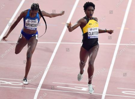Ashley Spencer of the United States, and Rushell Clayton of Jamaica, compete during the women's 400 meter hurdles semifinal's at the World Athletics Championships in Doha, Qatar