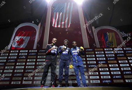 Stock Picture of Medalists Noah Lyles of the United States, gold, Andre de Grasse of Canada, silver, and Alex Quinonez of Ecuador, bronze, pose during the medal ceremony for the men's 200 meters at the World Athletics Championships in Doha, Qatar