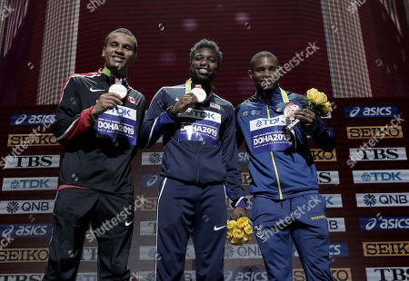 Men's 200 meter medalists Noah Lyles of the United States, gold, Andre de Grasse of Canada, silver, and Alex Quinonez of Ecuador, bronze, pose during the medal ceremony at the World Athletics Championships in Doha, Qatar