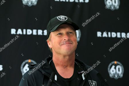 Oakland Raiders' head coach Jon Gruden gives a press conference after a practice session at the Grove Hotel in Chandler's Cross, Watford, England, . The Oakland Raiders are preparing for an NFL regular season game against the Chicago Bears in London on Sunday