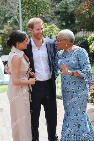 Meghan Duchess of Sussex and Prince Harry meet with Graca Machel, widow of Nelson Mandela at the High Commissioner's residence in Johannesburg, South Africa.