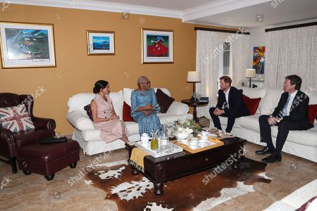Stock Picture of Meghan Duchess of Sussex and Prince Harry meet with Graca Machel, widow of Nelson Mandela at the High Commissioner's residence in Johannesburg, South Africa.