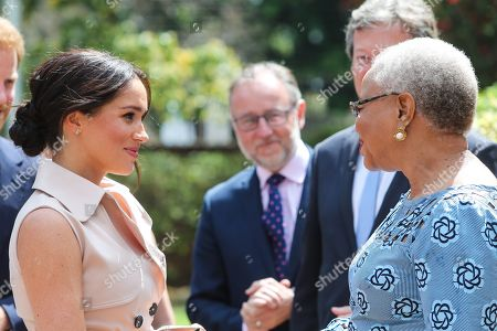Meghan Duchess of Sussex meets with Graca Machel, widow of Nelson Mandela at the High Commissioner's residence in Johannesburg, South Africa.