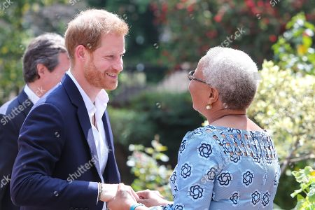 Prince Harry meets with Graca Machel, widow of Nelson Mandela at the High Commissioner's residence in Johannesburg, South Africa.