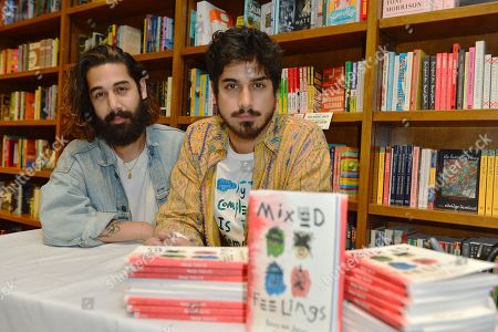 """Actor Avan Jogia and brother Ketam Jogia (L) pose for portrait after reading and sign copies of Avan Jogia poetry collection, """"Mixed Feelings: Poems & Stories"""""""