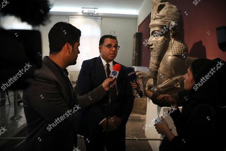 President of The Oriental Institute of the University of Chicago Professor Christopher Woods, center, speaks with journalists during a ceremony to unveil ancient clay tablets that were returned to Iran from U.S., at the National Museum of Iran, in Tehran, Iran, . Iran on Wednesday displayed 1783 clay tablets dating back 2500 years that it had loaned to the University of Chicago's Oriental Institute more than 80 years ago for research, translation and cataloging after the University archaeologists uncovered them in the 1930s in the ancient Iranian city of Persepolis. The U.S. and Iran have not had diplomatic relations since 1979