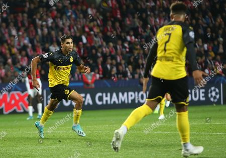Achraf Hakimi of Borussia Dortmund (L) reacts after scoring the 1-0 lead with Jadon Sancho (R) during the UEFA Champions League Group F match between Slavia Prague and Borussia Dortmund in Prague, Czech Republic, 02 October 2019.