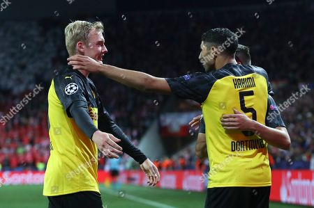 Achraf Hakimi (C) of Borussia Dortmund celebrates with Julian Brandt (L) after scoring the 2-0 lead during the UEFA Champions League Group F match between Slavia Prague and Borussia Dortmund in Prague, Czech Republic, 02 October 2019.