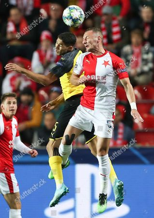 Vladimír Coufal (R) of Slavia Prague in action against Achraf Hakimi (L) of Borussia Dortmund during the UEFA Champions League Group F match between Slavia Prague and Borussia Dortmund in Prague, Czech Republic, 02 October 2019.