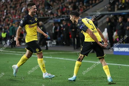 Achraf Hakimi of Borussia Dortmund (R) celebrates after scoring the 1-0 lead with Raphael Guerreiro (L) during the UEFA Champions League Group F match between Slavia Prague and Borussia Dortmund in Prague, Czech Republic, 02 October 2019.
