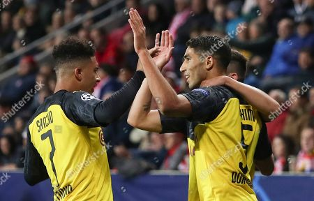 Achraf Hakimi of Borussia Dortmund (C) celebrates after scoring the 1-0 lead with team mates Jadon Sancho (L) and Raphael Guerreiro (R) during the UEFA Champions League Group F match between Slavia Prague and Borussia Dortmund in Prague, Czech Republic, 02 October 2019.