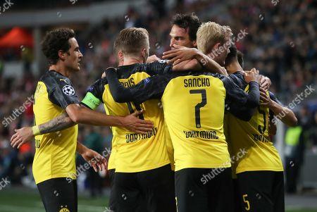 Borussia Dortmund team mates celebrate the goal of Achraf Hakimi (R) during the UEFA Champions League Group F match between Slavia Prague and Borussia Dortmund in Prague, Czech Republic, 02 October 2019.