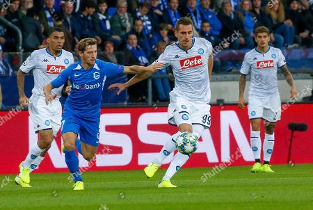 Genk's Theo Bongonda (L) in action against Napoli's Arkadiusz Milik (R) during the UEFA Europa League Group E soccer match between KRC Genk and SSC Napoli at Luminus Arena in Genk, Belgium, 02 October 2019.