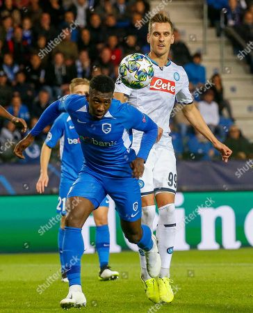 Genk's Carlos Cuesta (L) in action against Napoli's Arkadiusz Milik (R) during the UEFA Europa League Group E soccer match between KRC Genk and SSC Napoli at Luminus Arena in Genk, Belgium, 02 October 2019.