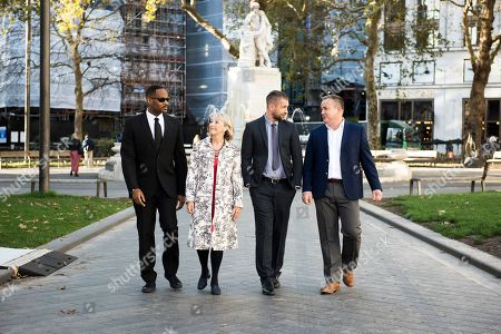 Lookalike Tom Hanks with Will Smith, Helen Mirren and Tom Hardy make their way to Leicester Square