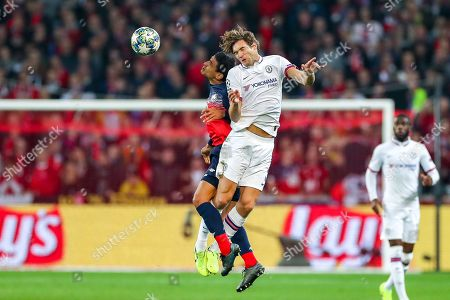 Chelsea defender Marcos Alonso (3) and Lille midfielder Benjamin Andre (21) clash in the air during the Champions League match between Lille OSC and Chelsea at Stade Pierre Mauroy, Lille